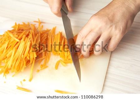 Carrots cutting - stock photo