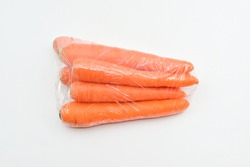 Carrots in plastic bag isolated on white background