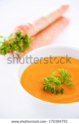 Carrots soup on white background