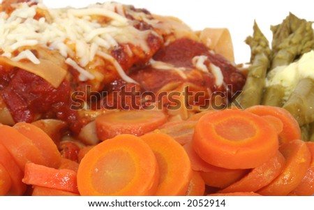 Carrots with Baked Chicken and Marinara Sauce Over Wheat Pasta and Asparagus