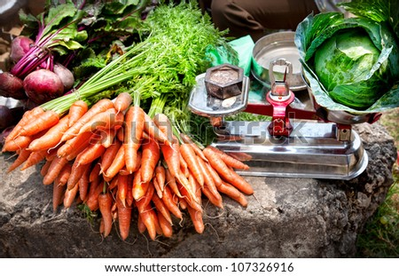 Carrots with leaves and beetroots near Cabbage on scales at the market, Kumly, Kerala, India
