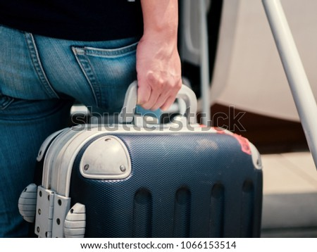 Carry-on luggage on the top shelf over head on airplane, passenger put bag cabin compartment air craft business class,vintage color,