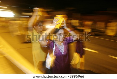 Carrying milkpots during Hindu festival of Thaipusam in Malaysia.