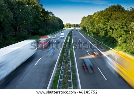 Cars and Trucks on a Motorway. Motion Blur.