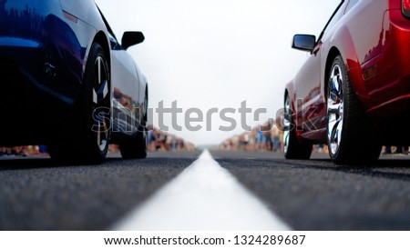 cars at the start, competitions, powerful cars, unlim 500, dragracing, red and blue auto at the start, a crowd of fans, muscle cars ready for dragrace,street car racers #1324289687