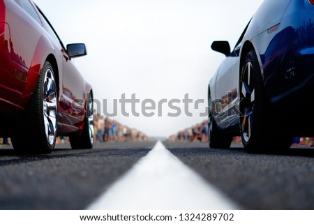cars at the start, competitions, powerful cars, unlim 500, dragracing, red and blue auto at the start, a crowd of fans, muscle cars ready for dragrace,street car racers #1324289702