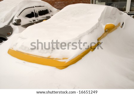 Cars buried deep in Snow Banks.