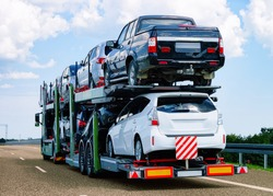 Cars carrier at the road of Poland. Truck transporter