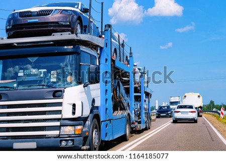 Cars carrier on the road, in Poland. Truck transporter #1164185077