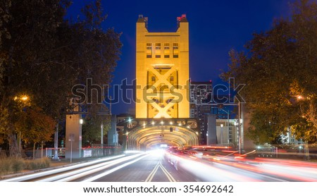 Cars come and go from the Tower Bridge at night in Sacramento #354692642