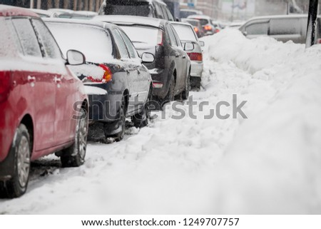Cars covered with fresh white snow #1249707757