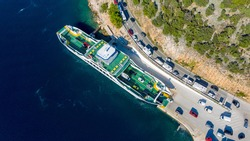 Cars disembark from the ferry aerial view photo