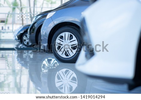 Cars For Sale. Automotive Industry. Cars Dealership Parking Lot. Rows of Brand New Vehicles Awaiting New Owners in the showroom.
