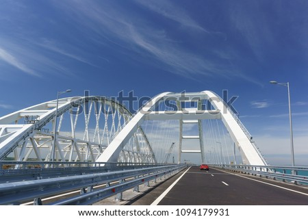 Cars go on the Crimean automobile bridge connecting the banks of the Kerch Strait: Taman and Kerch, Crimea. Russia #1094179931