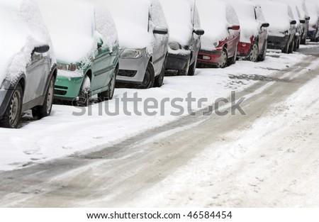 cars in city street in winter