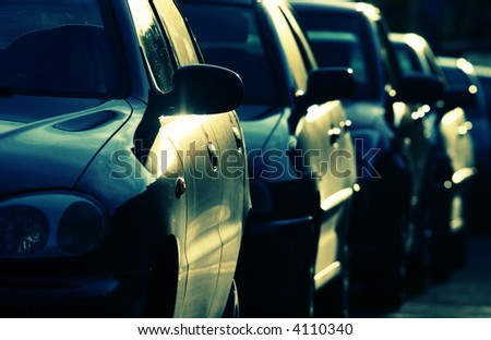 Cars in greenish-blue colors