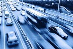 cars in highway with blur motion