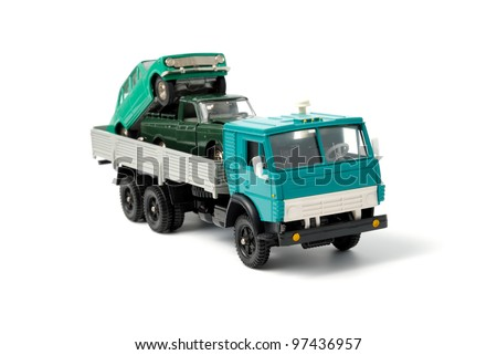 Cars in the back of toy truck on a white background