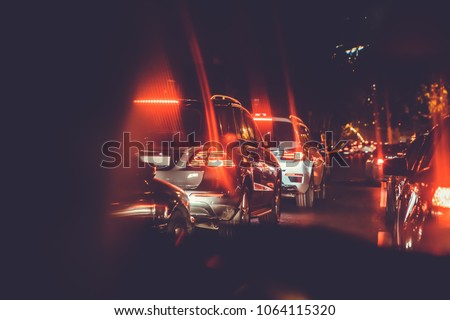 Cars in the night traffic jam . Looking behind the cars.Cars are red, yellow night light. Traffic jams in the city with row of cars on the road at night and bokeh lights in Baku with selective focus