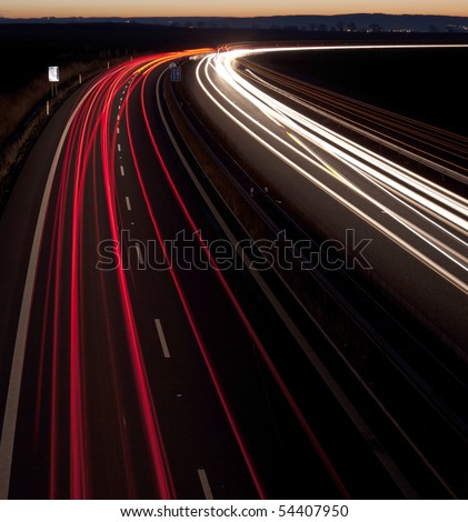 Cars moving fast on a highway