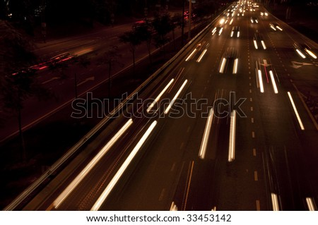 Cars moving on busy roads at night.
