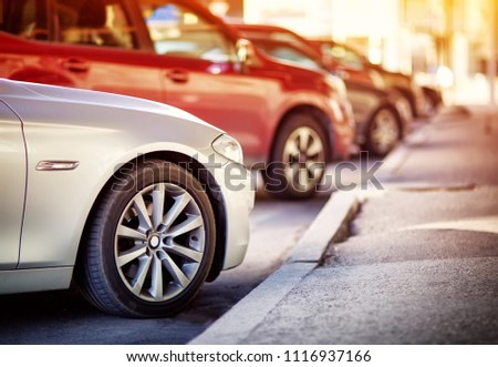 Cars moving on the road in city in early morning. View to the automobiles, parked in the town #1116937166