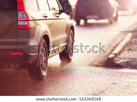 Cars moving on the road in city in early morning. View to the traffic and transport #563368168