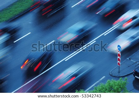 Cars moving over wet road background. Blurred motion.