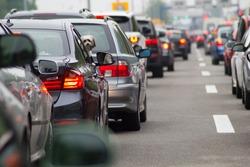 Cars on highway in traffic jam