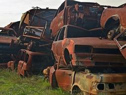 Cars on junkyard damaged in fire