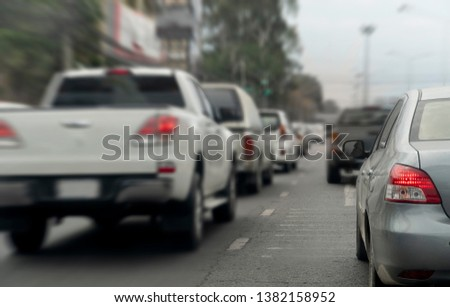 Cars on the road in traffic junction there are many cars on the road. #1382158952