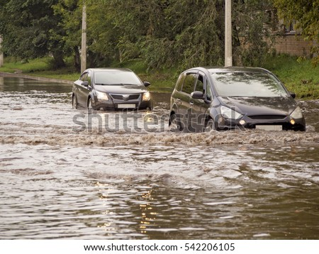 Cars on the street flooded with rain #542206105