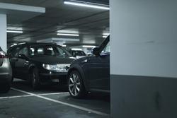 Cars parked in parking garage.