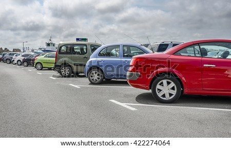 Shutterstock Cars parked in the parking lot. Close-up.