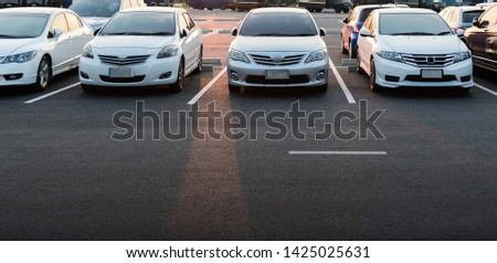 Cars parked in the parking lot. Parking Lot with Copy Writing Space #1425025631