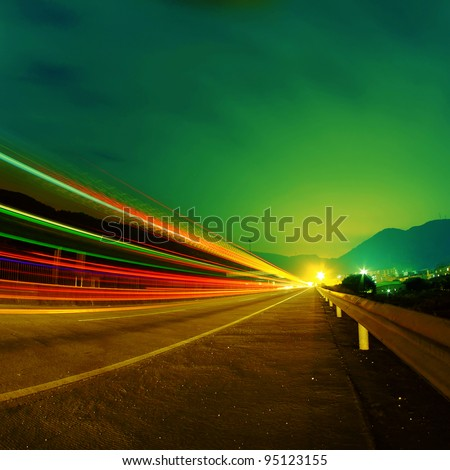 Cars pass on a country road at night #95123155
