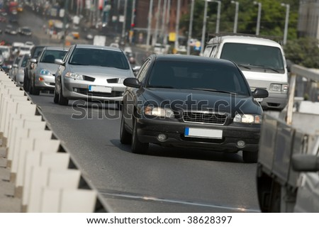 Cars passing by on a busy urban road