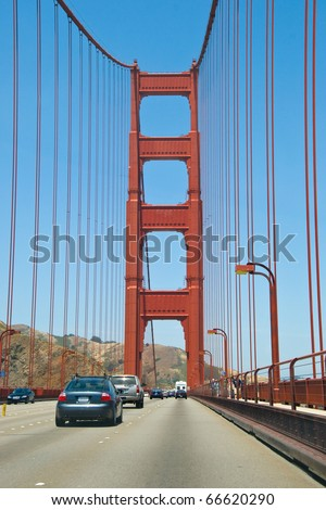 Cars passing Golden Gate Bridge in San Francisco