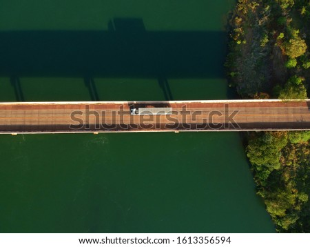 Cars passing over the bridge over a large river in the interior of Brazil