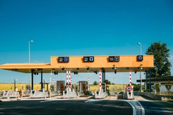 Cars Passing Through The Automatic Point Of Payment On A Toll Road. Point Of Toll Highway, Toll Station. Highway Toll Plaza Or Turnpike Or Charging Point, Entrance On Motorway.