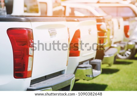 cars pickup truck in the parking lot outdoor patio lawn.