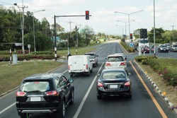 Cars stop red traffic light at the intersection of the Asian Highway