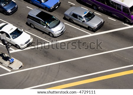 Cars stopped at a traffic junctions