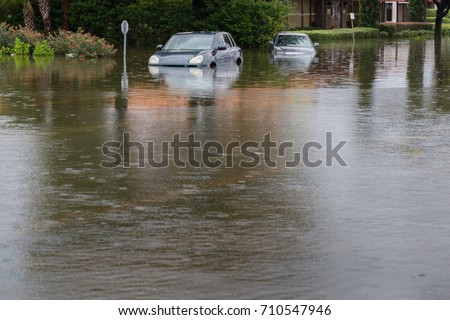 Cars submerged in Texas during hurricane Harvey. For hurricanes like Irma, formed in the Atlantic, climate models have high confidence that future storms will drop more rain and will have higher winds #710547946