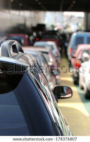 Cars waiting in the traffic.