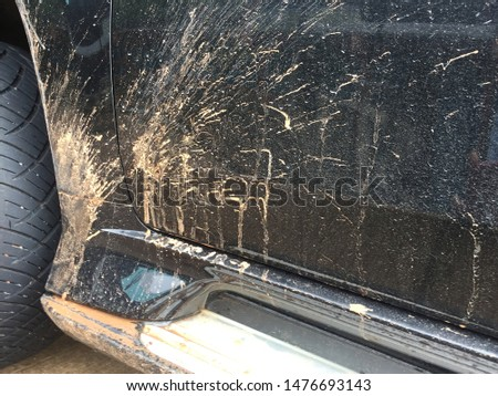 Cars with mud stains From wheels that come from dirty roads Should be cleaned