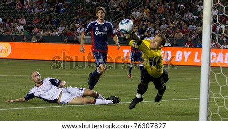 CARSON, CA. - APR 30:  Rajko Lekic shoots on Dan Kennedy during the Chivas USA vs. New England Revolution match on April 30, 2011 at the Home Depot Center in Carson, Ca.