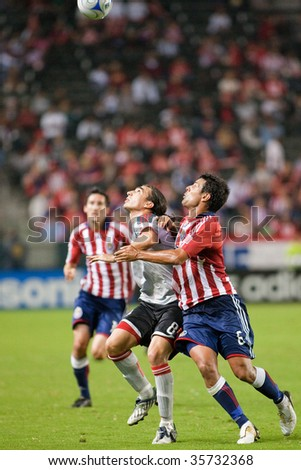 CARSON, CA. - AUGUST 22: Ante Jazic(R) Sacha Kljestan(L) & Pablo Vitti(M) fight for the ball during the Chivas USA vs. Toronto FC match on August 22, 2009 at the Home Depot Center in Carson.