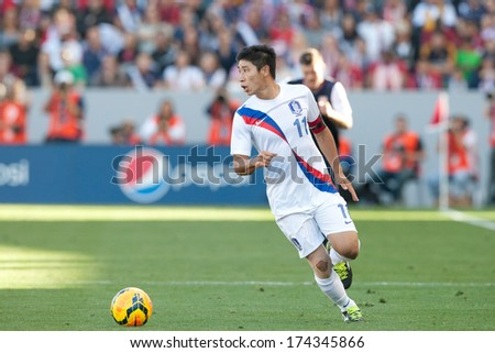 CARSON, CA. - FEB 01: Korea F Keun-Ho Lee #11 in action during the U.S. mens national team soccer friendly against Korea Republic on Feb 1st 2014 at the StubHub Center in Carson, Ca. - stock photo