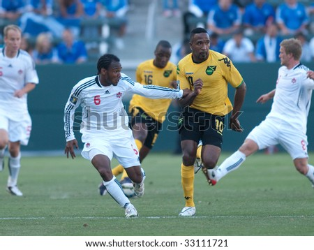 CARSON, CA. - JULY 3: Concacaf Gold Cup soccer match, Canada vs. Jamaica at the Home Depot center in Carson. Julian de Guzman and Ricardo Fuller move for postion on July 3, 2009.